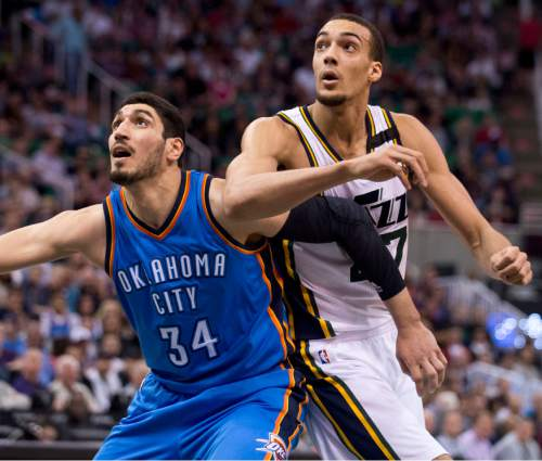 Lennie Mahler  |  The Salt Lake Tribune  Enes Kanter and Rudy Gobert battle for a rebound in the first half of a game between the Utah Jazz and Oklahoma City Thunder at EnergySolutions Arena on Saturday, March 28, 2015.