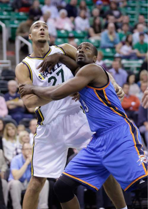 Utah Jazz center Rudy Gobert (27) and and Oklahoma City Thunder forward Serge Ibaka (9) battle under the boards in the first quarter during an NBA preseason basketball game Tuesday, Oct. 20, 2015, in Salt Lake City. (AP Photo/Rick Bowmer)