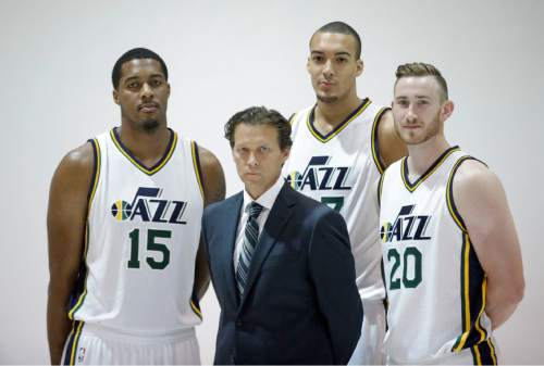 FILE - This Sept. 28, 2015, file photo, from left to right, shows Utah Jazz's Derrick Favors (15), head coach Quin Snyder, Rudy Gobert, of France, and Gordon Hayward (20) posed for a photograph during an NBA basketball media day, in Salt Lake City. The Utah Jazz find themselves in a bit of a predicament on the eve of the 2015-16 NBA season. General manager Dennis Lindsey kept the core of the team together after a strong finish to last season. He stuck to the slow rebuild philosophy and resisted the temptation spend lavishly in free agency.(AP Photo/Rick Bowmer, File)