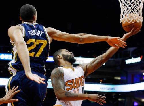 Phoenix Suns' Markieff Morris, right, gets past Utah Jazz's Rudy Gobert (27), of France, for a basket during the first half of an NBA preseason basketball game Friday, Oct. 9, 2015, in Phoenix. (AP Photo/Ross D. Franklin)