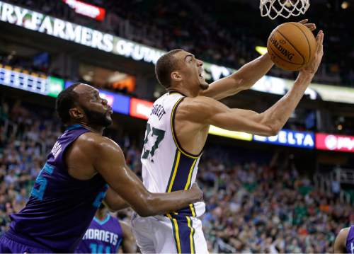 FILE - In this March 16, 2015, file photo, Charlotte Hornets center Al Jefferson, left, fouls Utah Jazz center Rudy Gobert during an NBA basketball game in Salt Lake City. The Jazz wrapped up a better-than-expected season Wednesday, April 15, and now look to a future in which expectations have risen. (AP Photo/Rick Bowmer, File)