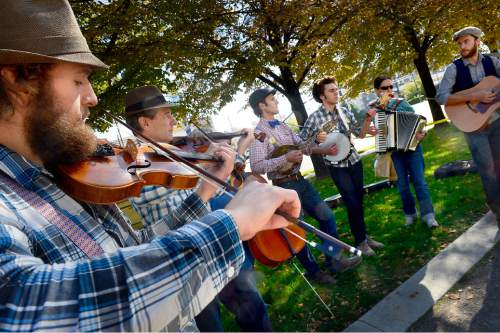 "Scott Sommerdorf   |  The Salt Lake Tribune ""Solaris"" plays at the last Farmers Market in Pioneer Park, Saturday, October 24, 2015."