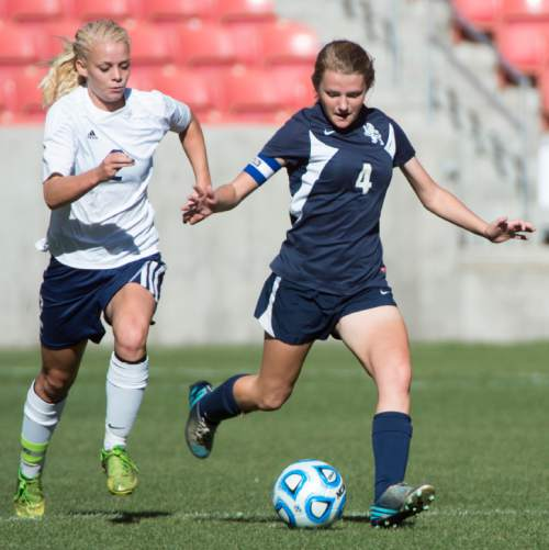 Rick Egan  |  The Salt Lake Tribune  Maeser Prep Lions, Sophie Cannon (4) goes after the ball, along with Millard Eagles Anna Camp (2) in the 2A girls soccer state title game at Rio Tinto Stadium, Saturday, October 24, 2015.
