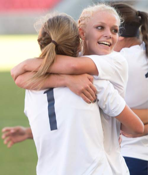 Rick Egan  |  The Salt Lake Tribune  The Millard Eagles Kaylin Crabb (1) hugs Anna Camp (2), asa they celebrate the Eagles 1-0 win over the Maeser Prep Lions, in the 2A girls soccer state title game at Rio Tinto Stadium, Saturday, October 24, 2015.