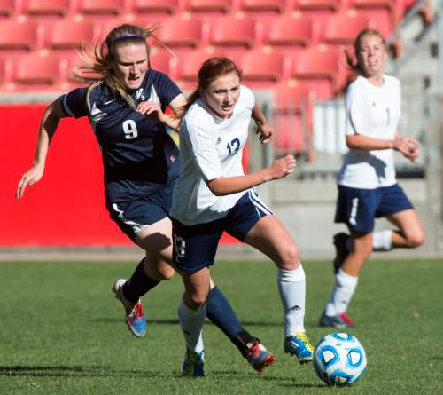 Rick Egan  |  The Salt Lake Tribune  Maeser Prep Lions Nikenzie Faber(9) , goes for the ball along with Millard's Madison Oliver (13) in the 2A girls soccer state title game at Rio Tinto Stadium, Saturday, October 24, 2015.