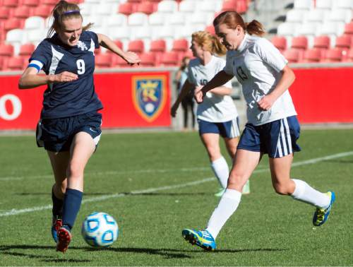 Rick Egan  |  The Salt Lake Tribune  Maeser Prep Lions Nikenzie Faber (9) , goes for the ball along with Millard's Madison Oliver (13) in the 2A girls soccer state title game at Rio Tinto Stadium, Saturday, October 24, 2015.