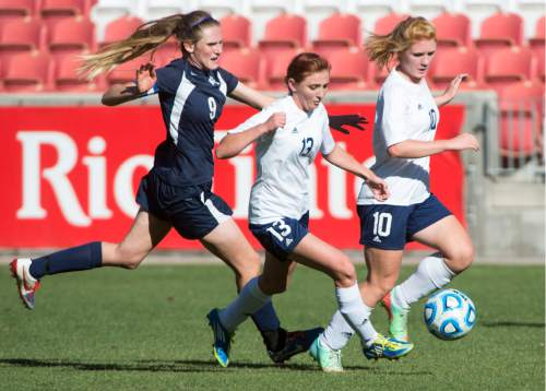 Rick Egan  |  The Salt Lake Tribune  Maeser Prep Lions Nikenzie Faber (9) , goes for the ball along with Millard's Madison Oliver (13) and Danielle Whitaker (10) in the 2A girls soccer state title game at Rio Tinto Stadium, Saturday, October 24, 2015.