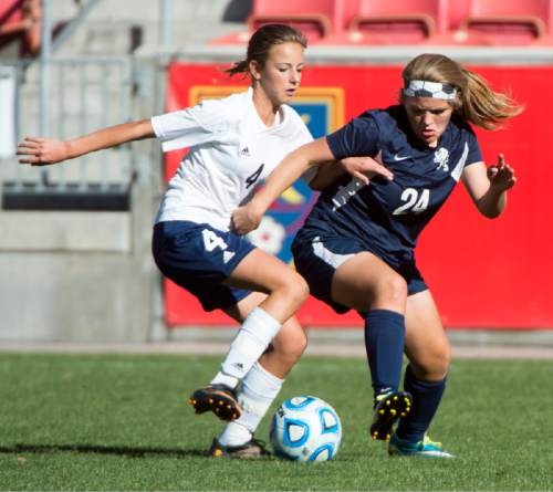 Rick Egan  |  The Salt Lake Tribune  The Millard Eagles Maria Josse (4) goes for the ball along with Cydne Baker (24) Maeser Prep Lions, in the 2A girls soccer state title game at Rio Tinto Stadium, Saturday, October 24, 2015.
