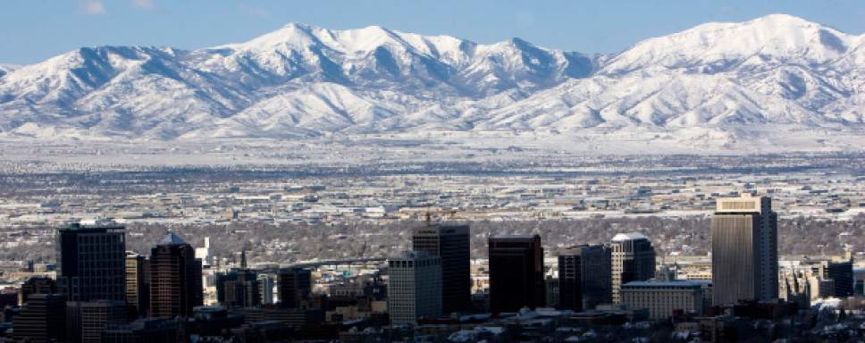 Salt Lake City - The morning sun fills the Salt Lake valley with sun leaving the skyline in shadows following a snow storm that covered the Wasatch Front with several inches of snow Monday March 31, 2008.  Steve Griffin/The Salt Lake Tribune 3/31/08