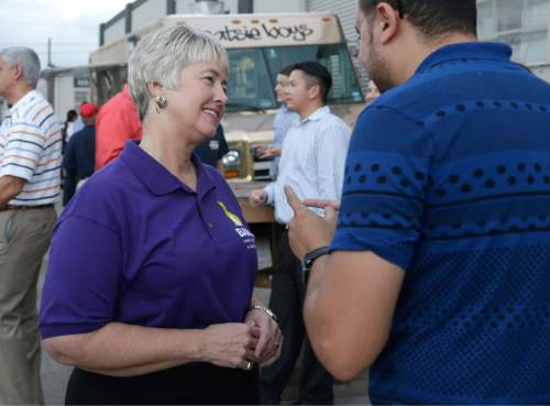 Houston Mayor Annise Parker, left, greets a supporter at a fund raiser for the Houston Equal Rights Ordinance in Houston on Thursday, Oct. 22, 2015. The ordinance is a broad measure that would consolidate existing bans on discrimination tied to race, sex, religion and other categories in employment, housing and public accommodations, and extend such protections to gays, lesbians, bisexuals and transgender people. (AP Photo/Pat Sullivan)