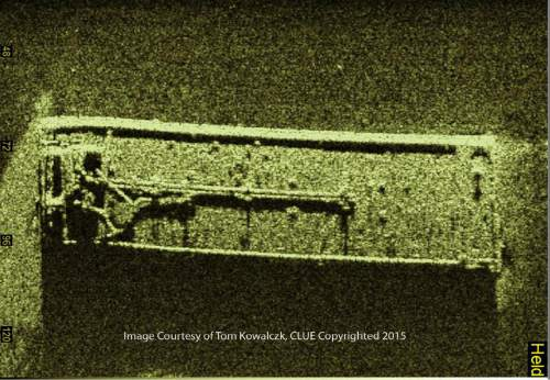 This undated image provided by Tom Kowalczk and created with a side scan sonar shows a sunken barge in Lake Erie. Underwater contractors are being sent to Lake Erie to search for the source of what appears to be a petroleum leak coming from the barge found recently in the lake near the U.S.-Canadian border, the U.S. Coast Guard said Sunday, Oct. 25, 2015. (Tom Kowalczyk via AP) MANDATORY CREDIT