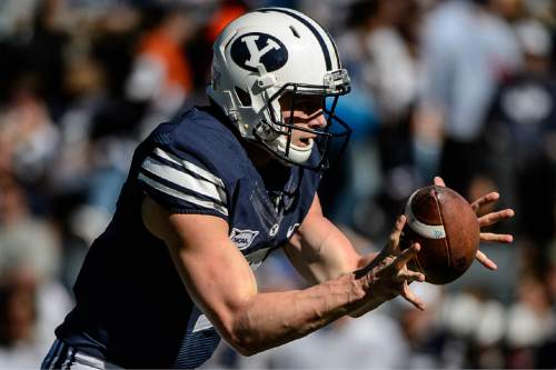 Trent Nelson     The Salt Lake Tribune Brigham Young Cougars quarterback Beau Hoge (7) takes a snap as BYU hosts Wagner, NCAA football at LaVell Edwards Stadium in Provo, Saturday October 24, 2015.