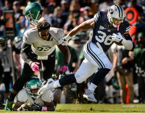 Trent Nelson     The Salt Lake Tribune Brigham Young Cougars running back Francis Bernard (36) runs away from Wagner Seahawks linebacker Stephon Font-Toomer (33) as BYU hosts Wagner, NCAA football at LaVell Edwards Stadium in Provo, Saturday October 24, 2015.