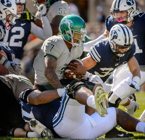 Trent Nelson     The Salt Lake Tribune Wagner Seahawks quarterback Chris Andrews (7) is sacked as BYU hosts Wagner, NCAA football at LaVell Edwards Stadium in Provo, Saturday October 24, 2015.