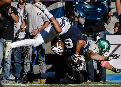 Trent Nelson     The Salt Lake Tribune Wagner Seahawks linebacker Nick Menocal (17) brings down Brigham Young Cougars wide receiver Trey Dye (6) as BYU hosts Wagner, NCAA football at LaVell Edwards Stadium in Provo, Saturday October 24, 2015.