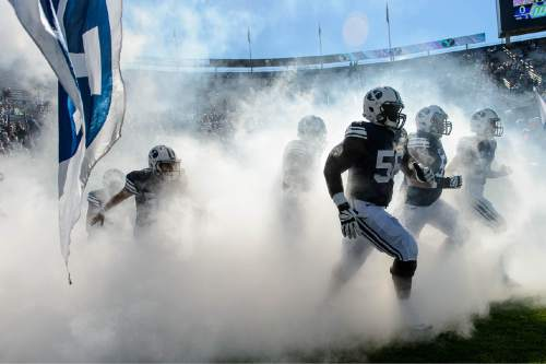 Trent Nelson     The Salt Lake Tribune BYU players storm out of the fog as BYU hosts Wagner, NCAA football at LaVell Edwards Stadium in Provo, Saturday October 24, 2015.