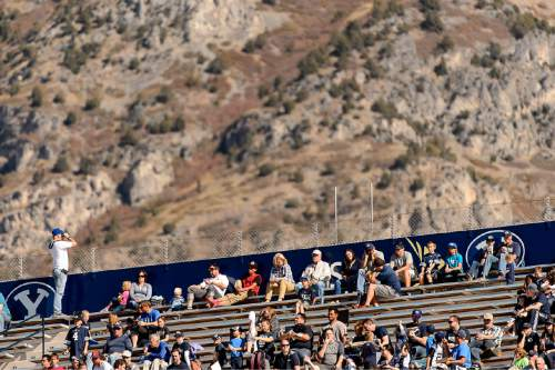 Trent Nelson     The Salt Lake Tribune A BYU fan finds the scenery outside the stadium of more interest as BYU leads Wagner 49-0 in the first half, NCAA football at LaVell Edwards Stadium in Provo, Saturday October 24, 2015.