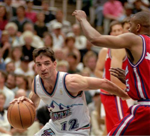 Utah Jazz guard John Stockton glides past Los Angeles Clippers guard Darrick Martin on his way to the basket in the fourth quarter Saturday, April 26, 1997, in Salt Lake City.  The Jazz beat the Clippers 105-99 to take a 2-0 lead in the first round of their playoff games.  (AP Photo/Douglas C. Pizac)