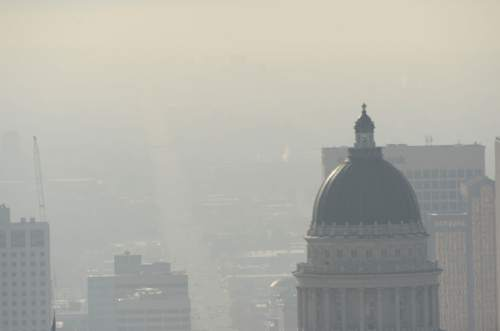 Al Hartmann  |  The Salt Lake Tribune View from the Utah State Capitol looking south down State Street.  Air pollution, (pm 2.5) begins building up in downtown Salt Lake City Tuesday Jan. 6.  It looks worse than it is.  The Utah Department of Environmental Quality's measurement was about 20  for pm 2.5, putting it into the yellow mandatory action range.  Stay tuned for more of the same for the next few days.
