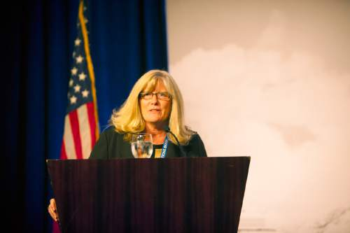|  Courtesy Utah Media Group  Rocky Mountain Power CEO Cindy Crane announces the utility's Sustainable Transportation and Energy Plan on Tuesday October 27, 2015, at the Governor's Air and Energy Symposium.