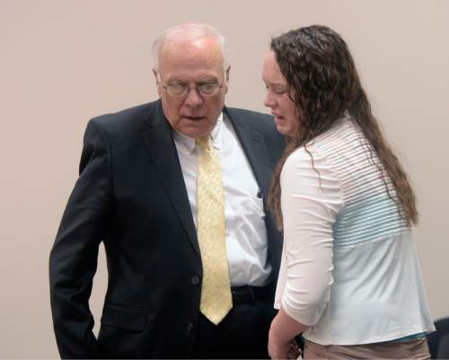 Al Hartmann |  The Salt Lake Tribune Defense lawyer Dean Zabriskie consoles Meagan Grunwald at the conclusion of her trial in Provo Friday May 8.  Grunwald is charged as an accomplice in a shooting spree that killed one police officer and wounded another on January 30, 2014.