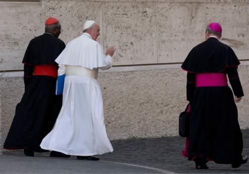 Pope Francis leaves at the end of a morning session of the Synod of bishops, Thursday, Oct. 15, 2015. (AP Photo/Alessandra Tarantino)