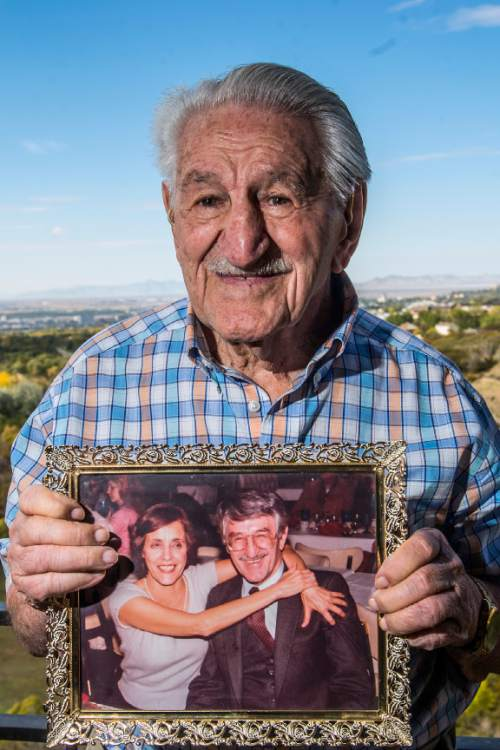 Chris Detrick  |  The Salt Lake Tribune Señor Pepe's founder Louis Nichols holds a picture of he and his wife Athena at his home in Salt Lake City Wednesday October 21, 2015.