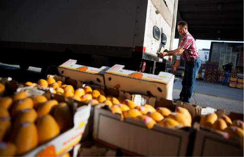 In this June 6, 2015, photo, Michael Gipson, of Tracy City, Tenn., closes the door to his truck after loading up produce at the Atlanta Farmers Market in Atlanta. The Commerce Department issues the first of three estimates of how the U.S. economy performed in the July-September quarter on Thursday, Oct. 29, 2015. (AP Photo/David Goldman)