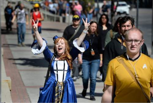 Scott Sommerdorf   |  The Salt Lake Tribune Costumed visitors make their way along the sidewalk at the opening day of Comic Con in Salt Lake City, Thursday, September 23, 2015.