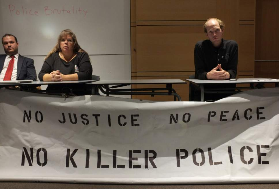 Steve Griffin  |  The Salt Lake Tribune  Gina Thayne, who was representing the family of Dillon Taylor, and Chris Manor, right,  of Utah Against Police Brutality, moderates the organization's first public meeting to discuss and plan out goals which will work towards winning justice for the people. The meeting was held at the Main Library in Salt Lake City, Wednesday, November 19, 2014.
