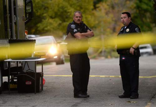 Al Hartmann  |  The Salt Lake Tribune Scene of early morning double shooting-homicide Thursday Oct. 29 between a homeowner and assailant in Millcreek area of Salt Lake County.  Unified Police Dept. investigate the crime scene.
