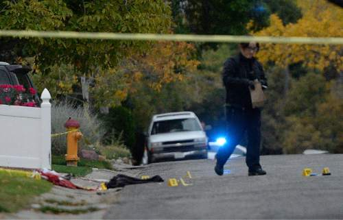 Al Hartmann  |  The Salt Lake Tribune Scene of early morning double shooting-homicide Thursday Oct. 29 between a homeowner and assailant in Millcreek area of Salt Lake County.  Unified Police Dept. investigate the crime scene where the bodies fell.