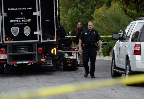 Al Hartmann  |  The Salt Lake Tribune Scene of early morning double shooting-homicide Thursday Oct. 29 between  a homeowner and assailant in Millcreek area of Salt Lake County.  Unified Police Dept. investigate the crime scene