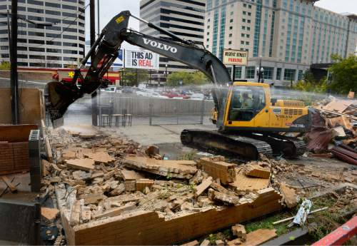 Scott Sommerdorf   |  The Salt Lake Tribune The final walls of the long-abandoned Eat-a-Burger are being brought down as the old restaurant on Regent Street was demolished, Thursday, October 29, 2015.