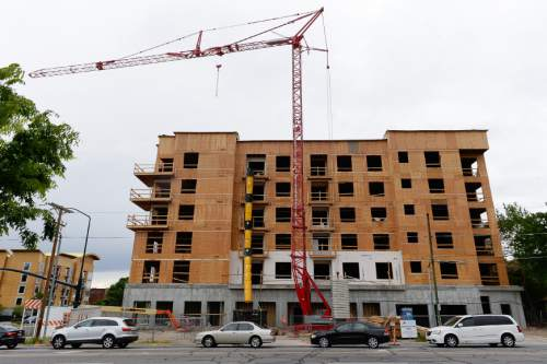 Francisco Kjolseth  |  The Salt Lake Tribune  A new high-rise housing project goes up on 400 South at 500 East in Salt Lake City.