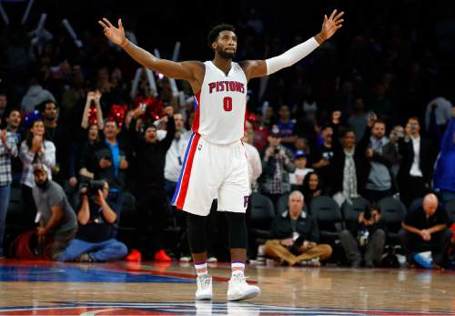 Detroit Pistons center Andre Drummond celebrates in the closing moments of a 92-87 victory over the Utah Jazz in an NBA basketball game Wednesday, Oct. 28, 2015, in Auburn Hills, Mich. (AP Photo/Paul Sancya)