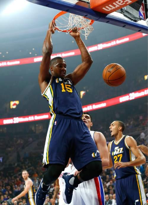 Utah Jazz forward Derrick Favors (15) dunks on the Detroit Pistons in the first half of an NBA basketball game Wednesday, Oct. 28, 2015, in Auburn Hills, Mich. (AP Photo/Paul Sancya)