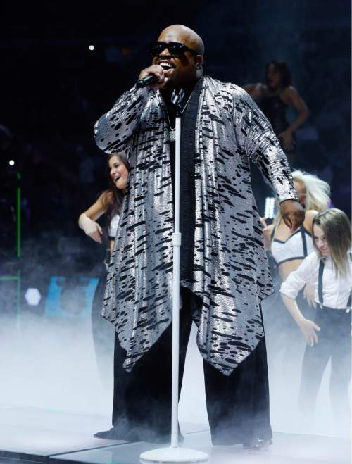 Recording artist CeeLo Green performs during halftime of an NBA basketball game between the Utah Jazz and the Detroit Pistons, Wednesday, Oct. 28, 2015, in Auburn Hills, Mich. (AP Photo/Paul Sancya)
