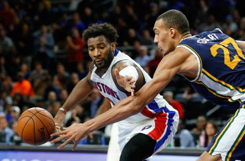 Detroit Pistons center Andre Drummond (0) and Utah Jazz center Rudy Gobert (27) reach for the ball in the second half of an NBA basketball game Wednesday, Oct. 28, 2015, in Auburn Hills, Mich. (AP Photo/Paul Sancya)