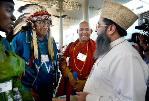 Scott Sommerdorf   |  The Salt Lake Tribune Chief Arvol Looking Horse, 19th Generation Keeper of the Sacred White Buffalo Calf Pipe and Leader of the Lakota Dakota Nakota Oyate, the Great Sioux Nation, second from left, greets Imam Umer Ahmed Ilyasi, Chief Imam, and Representative of Half a Million Imams of India, at the Parliament of World Religions Conference at the Salt Palace, Thursday, October 15, 2015.  At left is Imam Abdul Kareem Majemu, Ameer and Chief Imam of The Islamic Platform Society of Nigeria.  At center is the Venerable Bhikkhu Sanghasena (Founder of Mahabodhi International Meditation Centre (MIMC) in Leh, Ladakh, India.
