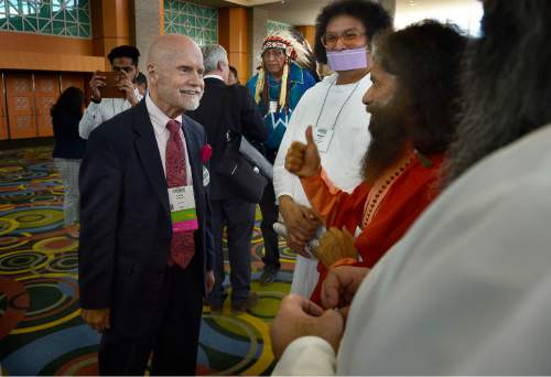 Scott Sommerdorf   |  The Salt Lake Tribune Rev. Dr. Larry L. Greenfield, Executive Minister for the American Baptist Churches of Metro Chicago and sits on the Board of Directors of the Council for the Parliament of the World's Religions, meets with Pujya Swami Chidanand Saraswati (called Pujya Swamiji or Pujya Muniji by disciples), the President and spiritual head of the Parmarth Niketan Ashram in Rishikesh, India, at the Parliament of World Religions Conference at the Salt Palace, Thursday, October 15, 2015.