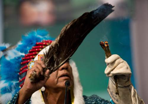 Lennie Mahler  |  The Salt Lake Tribune  Larry Cesspooch of the Ute Tribe leads a prayer in the opening plenary at the 2015 Parliament of the World's Religions held inside the Salt Palace Convention Center on Thursday, Oct. 15, 2015, in Salt Lake City.