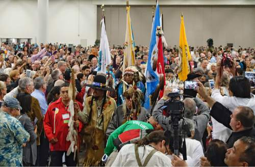 Lennie Mahler  |  The Salt Lake Tribune  Members of the Ute Tribe lead the procession for the opening plenary at the 2015 Parliament of the World's Religions held inside the Salt Palace Convention Center on Thursday, Oct. 15, 2015, in Salt Lake City.