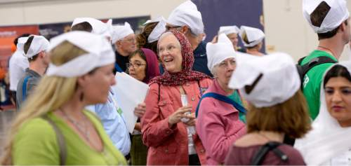 Al Hartmann  |  The Salt Lake Tribune Participants at theParliament of the World's Religions talk and wear obligatory head coverings while waiting to be seated and served food at a traditional Langar.  Langar is a 500-year-old Sikh religion tradition where vegetarian food is served to all for free, regardless of religion or class.  Langar expresses the ideals of community, sharing and oneness of mankind. Several thousand sat together as equals on the floor of the Salt Palace Convention Center Friday, Oct. 16 and were served by dozens of Sikh volunteers.