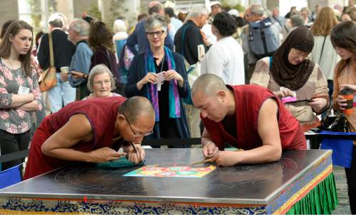 Al Hartmann  |  The Salt Lake Tribune Buddhist monks from the Drepung Loseling Monastery create an intricate Mandala sand painting one grain of sand at a time at the Parliament of the World's Religions inside the Salt Palace Convention Center  Friday, Oct. 16 in Salt Lake City.  It takes monks 3-5 days to complete a Mandala.  An estimated 9500 people from 50 religions will attend the event from Oct. 15-19. Diverse, religious female leaders share their collective wisdom for the empowerment of all and celebrate achievements within the interfaith movement.