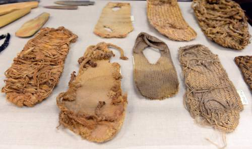 Al Hartmann  |  The Salt Lake Tribune Sandals are among the hundreds of artifacts the BLM seized in the Blanding raids five years ago. All the items are now sorted and documented.  The BLM hopes to repatriate the ceremonial items to tribes and send other pieces to museums.  Unfortunately they have little information about where they were looted.