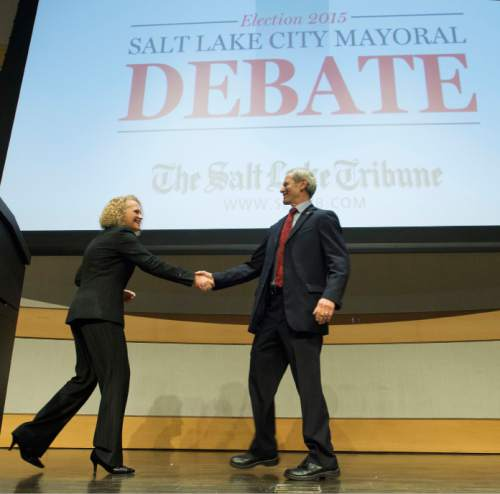 Steve Griffin  |  The Salt Lake Tribune  Jackie Biskupski and Ralph Becker shake hands after a Salt Lake City Mayoral debate at the Main Salt Lake City Library in Salt Lake City, Wednesday, October 28, 2015.