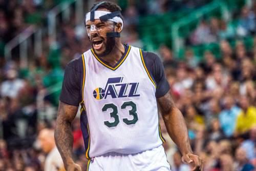 Chris Detrick  |  The Salt Lake Tribune Utah Jazz forward Trevor Booker (33) celebrates after scoring during the game at EnergySolutions Arena Thursday October 22, 2015.