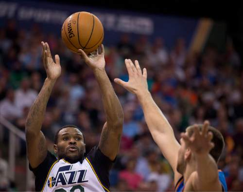 Lennie Mahler  |  The Salt Lake Tribune  Trevor Booker shoots over Mitch McGary in the first half of a game between the Utah Jazz and Oklahoma City Thunder at EnergySolutions Arena on Saturday, March 28, 2015.