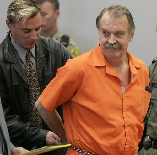 FILE - In this Oct. 6, 2005 file photo, convicted murderer and Death Row inmate Ron Lafferty is handcuffed after his court hearing in a courtroom in Provo, Utah. Utah, the only state in the past 40 years to carry out a death sentence by firing squad, is poised to bring back the Old West-style executions if the state cannot track down drugs used in lethal injections. The Republican-controlled state Legislature gave final approval to the proposal Tuesday, March 10, 2015, with lawmakers billing it as a backup plan as states struggle to find execution drugs amid a nationwide shortage. (AP Photo/George Frey, File)